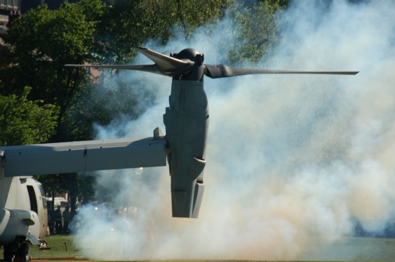 Marine Week Boston, 2010: Bell-Boeing MV-22B Osprey tilt-rotor aircraft kicking up a cloud of smoke from the engines before taking off from Boston Common